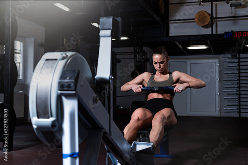 Young strong fit sweaty powerful attractive muscular woman with big muscles doin Fototapet