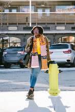 Portrait Confident, Stylish Young Woman Leaning On Fire Hydrant