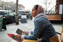 Young Woman In Headscarf Readi...