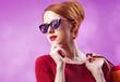 Leinwandbild Motiv Redhead women with shopping bags on purple background.