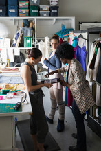 Female Fashion Designers And Ballerina With Digital Tablet Talking Wor