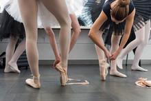 Elegant Female Ballerinas Putt...