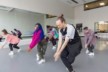 Hip-hop Dancers Practicing In Dance Studio