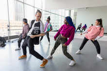 Hip-hop Dancers Rehearsing In ...