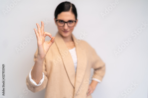 Fotomural Sympathic young woman with glasses showing everything alright