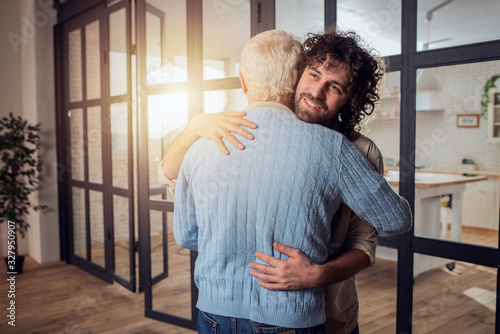 Dad and son hug each other at home Canvas Print