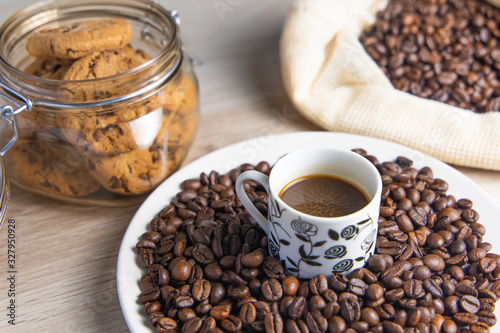 Fototapety, obrazy: Coffee beans on plate and in coffee bag with cookie jar