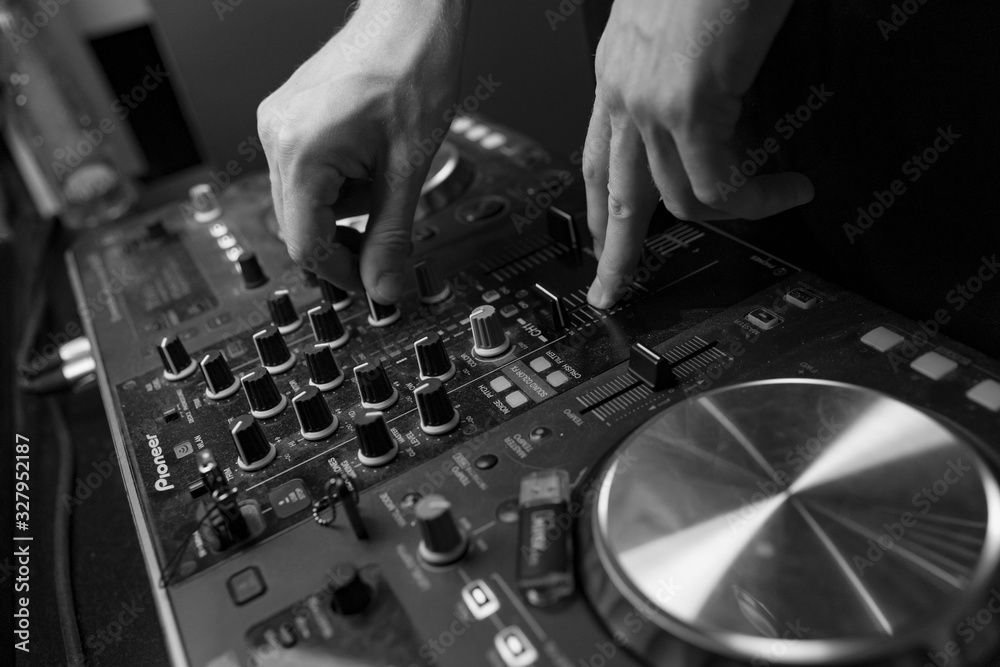 Fototapeta dj mixing music in club