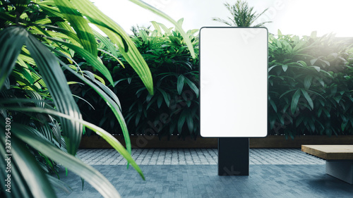 Valokuva Mock up of blank white vertical light box with the green trees on the background