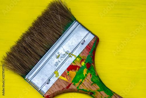 Close up of a brush with reggae colors on it ,  bright background Tapéta, Fotótapéta