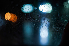 Bokeh Of City Behind The Rainy...