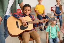 Teacher Giving Music Lessons A...