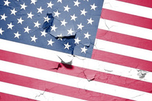 The Image Of The US Flag Is All In Cracks And Scuffs, At An Angle.