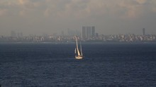 Single Masted Sailing Ship Cruising To Istanbul City. Sailing Ship Under Full Sail Out Prince Islands In Istanbul.