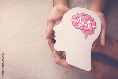 Photo Adult and child hands holding encephalography brain paper cutout, Epilepsy and a