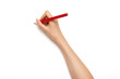 Woman hand hold a red pencil isolated on white.