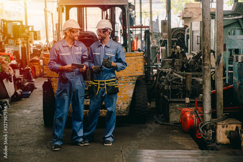 happy worker, working in heavy industry talking smiling together. Canvas Print