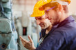 canvas print picture - happy worker, smiling industrial technician engineer enjoy working together with coworker.
