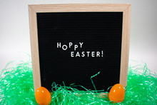 A Black Happy Easter Sign With...