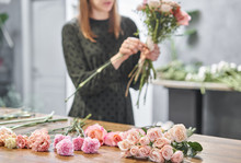 Woman Florist Creating Beautif...