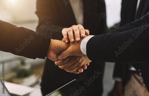 Close up on hands of business people join together their hands together on unity Poster Mural XXL