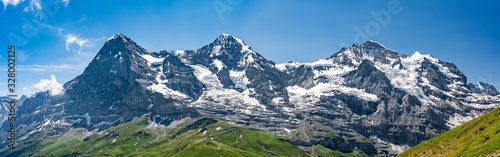 Fotografie, Obraz Switzerland, Panoramic view on Eiger, Monch and Jungfraujoch and green Alps arou