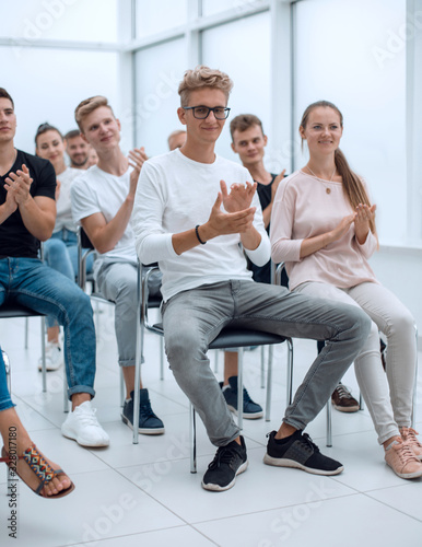 group of young people applaud at a group meeting Wallpaper Mural