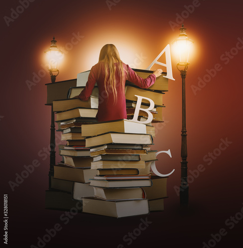 Girl Studying Books in Library Lit by Retro Gas Lamps in Late Evening Canvas Print