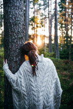 Woman Leaning Against A Tree D...