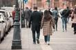 A couple walk along a city