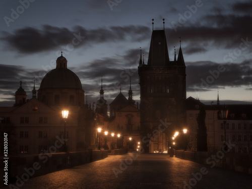 Obraz Foggy morning on empty, not crowded Charles Bridge in Prague - fototapety do salonu