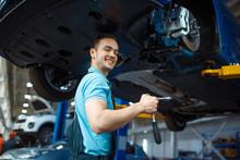Repairman Repairing Vehicle On...