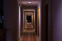Long Straight Corridor Of A Hotel Hotel With Dark Lighting