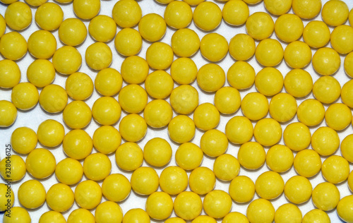 Many yellow round dragees of ascorbic acid vitamin C isolated on white backgroun Canvas Print