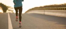 Fitness Woman Running On City ...