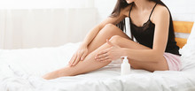 Young Woman Pampering Her Legs...