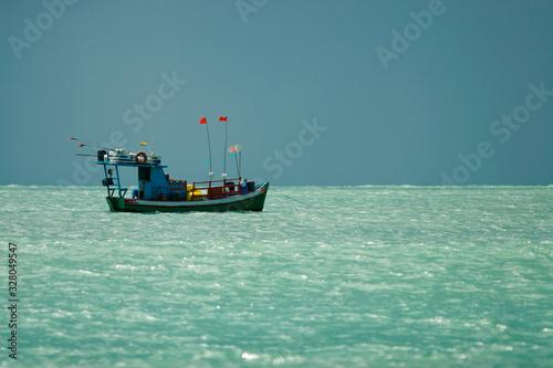 barco de pesca no mar de Natal, Rio Grande do Norte, Brasil Canvas Print