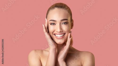 Obraz Beautiful Woman Touching Smooth Facial Skin Smiling Posing In Studio - fototapety do salonu