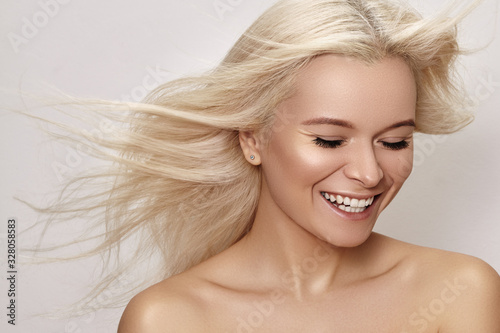 Fototapeta Beautiful smiling woman with magnificent blond hair