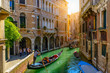 canvas print picture - Narrow canal with gondola and bridge in Venice, Italy. Architecture and landmark of Venice. Cozy cityscape of Venice.
