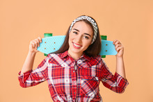 Stylish Young Woman With Skateboard On Color Background