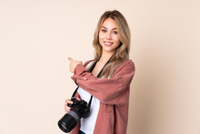 Young Photographer Girl Over Isolated Background Pointing Back