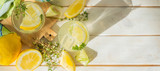 Detox drinks infused water and ingredients on wood background, copy space