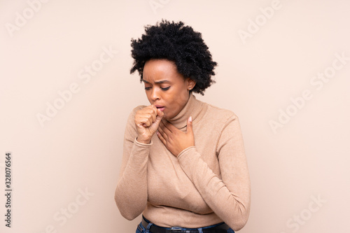 Obraz na plátně African american woman over isolated background is suffering with cough and feel