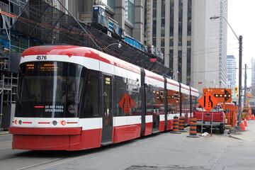 Toronto Streetcar running along the tram lines on Downtown Toronto