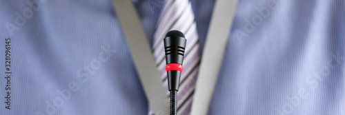 Fototapeta Man wearing necktie standing at conference microphone obraz