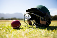 Cricket Ball And Helmet