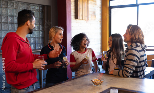 Friends talking while drinking and eating