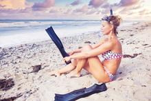 Blond Woman In Bikini With Swi...