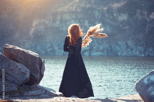 girl in a long black dress Canvas-taulu